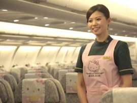 Flight attendant on EVA airline Hello Kitty plane.