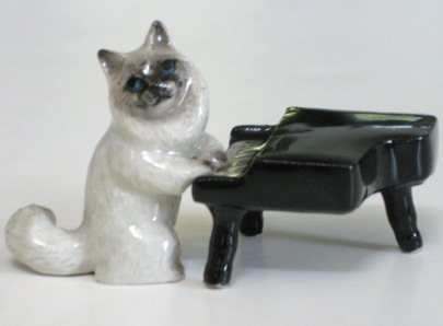 Miniature cat with piano