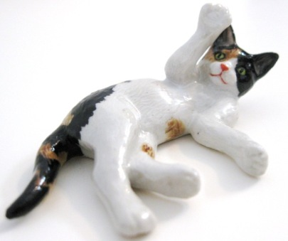 Miniature calico cat figurine