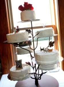Seven separate cakes with one that showcased the cats.